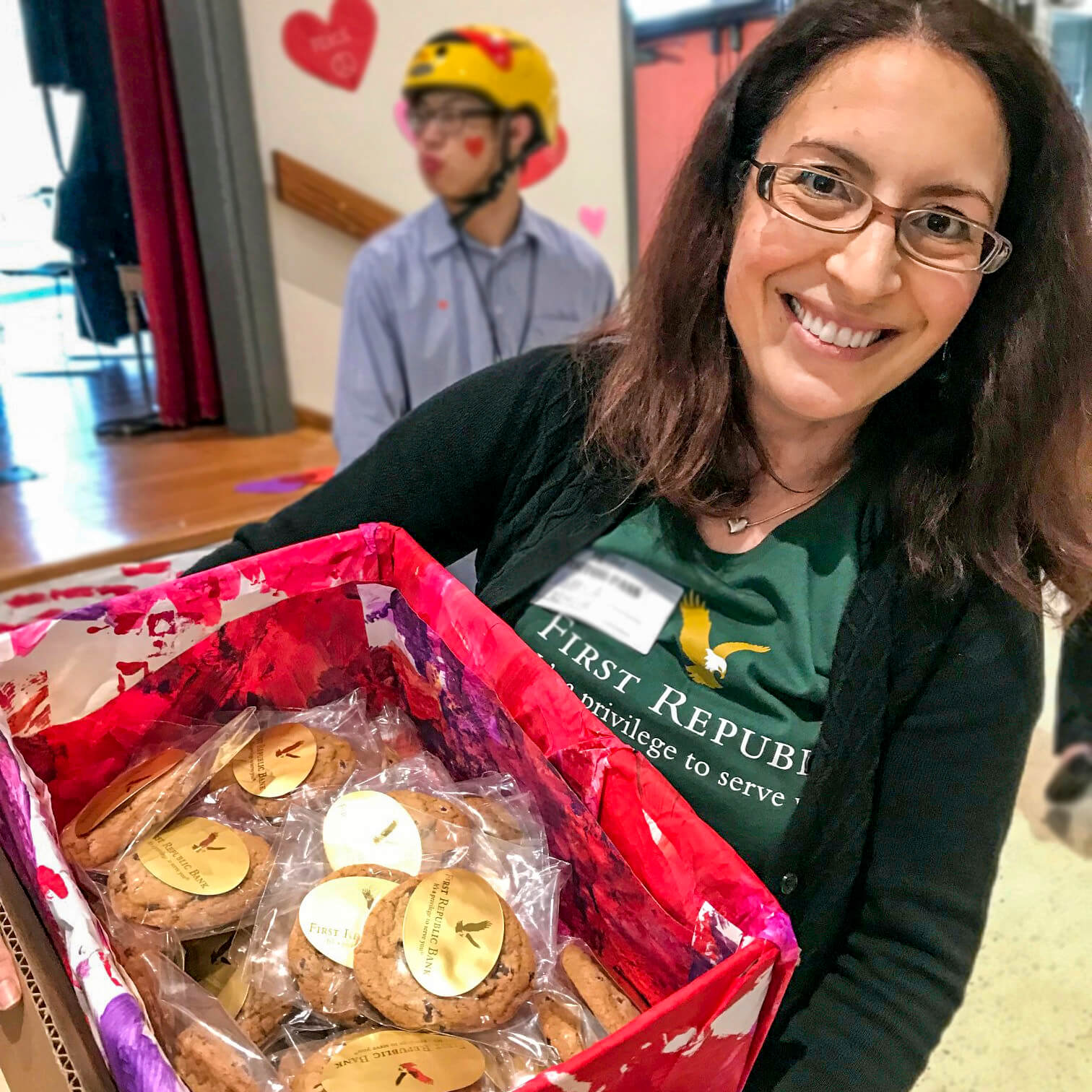 First Republic Volunteers woman holding cookies