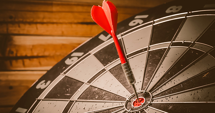 Strategy concept with dart in bullseye