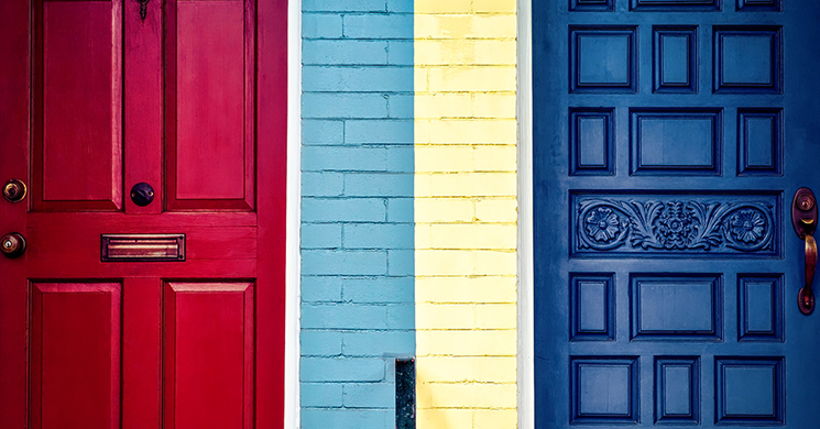 Colorful doors of a duplex simulate real estate investment.