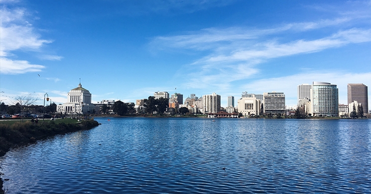 an image of lake merritt in oakland california brings to mind the issues to consider when buying a home in the east bay