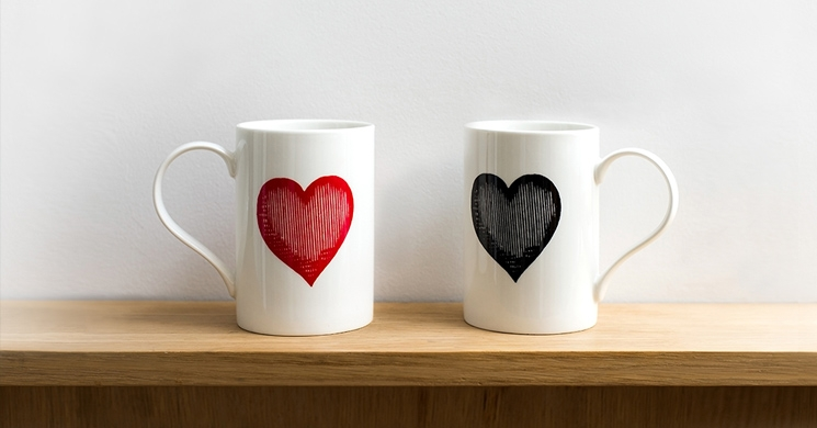 two coffee mugs with hearts on them sitting side-by-side with bring to mind the issues that unmarried couples face