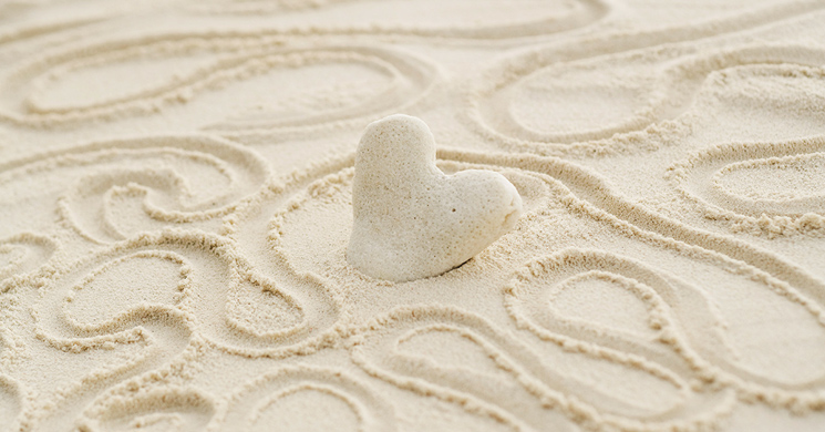 an image of a heart in the sand brings to mind estate planning and inheritance