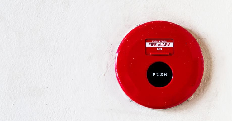 an image of a fire alarm brings to mind the response protocol one should have on hand to address cyber security breaches