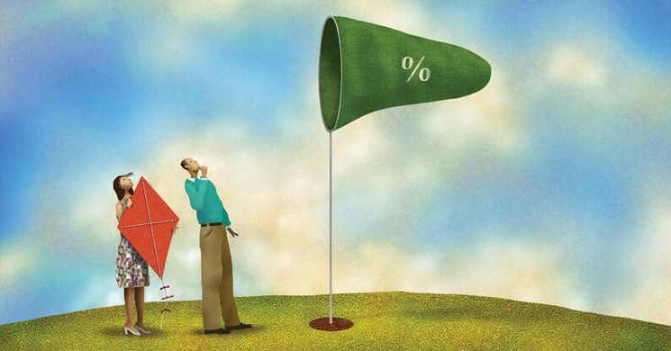 an illustration of a couple with a kite looking at a wind catcher brings to mind the question of how and why the federal reserve raises interest rates